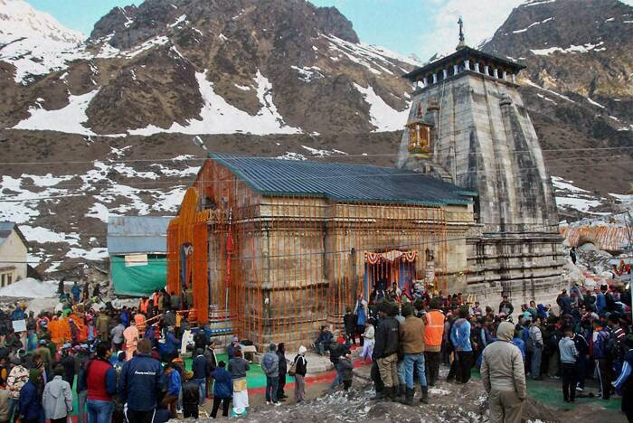 Chief priest of the shrine (Rawal) Bhima Shankar Ling presided over the rituals as its gates were opened amid chanting of vedic hymns, Badrinath-Kedarnath temple committee CEO V D Singh told PTI over phone. <br /><br /> About 1,252 devotees including eight foreign nationals visited the shrine on the opening day, he said. It is the first 'Char Dham' yatra after last year's calamity. (PTI)