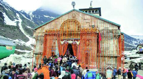 Devotees queue outside the Kedarnath temple to offer their prayers on Sunday. (Virender Negi)