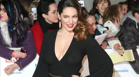 Kelly Brook stripped down to underwear for Cosmopolitan's Health and Fitness magazine.
