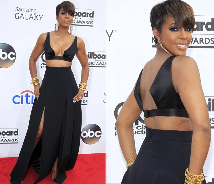 Kelly Rowland was another one who dared it all! Kelly's black dress featuring a revealing bodice and thigh high slit was not the best of the red carpet at the awards night. (Source: Reuters)