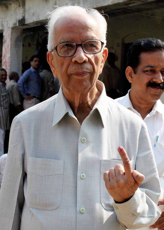 BJP senior leader Kesari Nath Tripathi shows his ink marked finger after casting vote in Phulpur on Wednesday. (PTI)