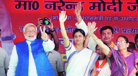 Narendra Modi with Apna Dal president Krishna Patel and party leader Anupriya Patel at an election rally in Mirzapur on Friday. PTI