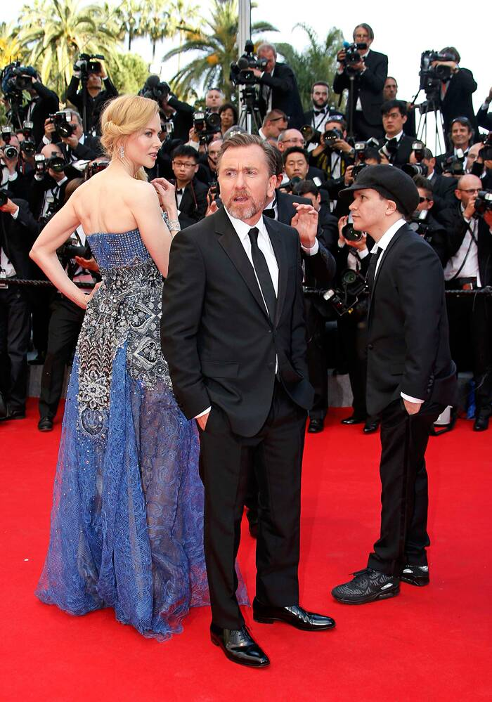"Cast members Nicole Kidman (L) and Tim Roth (C), director Olivier Dahan pose on the red carpet as they arrive for the opening ceremony and the screening of the film ""Grace of Monaco"" (Grace de Monaco) out of competition during the 67th Cannes Film Festival in Cannes May 14, 2014. (AP)"
