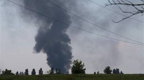 Rebels in eastern Ukraine shot down a government military helicopter Thursday amid heavy fighting around the eastern city of Slovyansk, killing 14 soldiers including a general. (Source: AP)