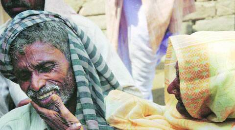 The parents of the younger of the victims on Friday. ( Source: Express photo by Gajendra Yadav )