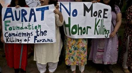 Members of Pakistan's civil society, hold banners and chant slogans, during a protest to condemn the killing of pregnant woman Farzana Parveen, who was stoned to death, in Islamabad, Pakistan. (Source: AP)