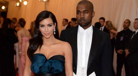 According to the invite, Kim Kardashian and Kanye West's wedding will take place in Paris on May 24. (AP Photo)