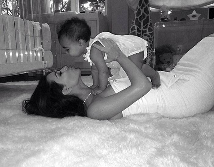 "Reality TV star Kim Kardashian celebrated her first Mother's Day as a mom with daughter North West on Sunday (May 11). Kim Kardashian posted a picture of hers with North on a social netwrking website captioning it, ""This little girl has changed my world in more ways than I ever could have imagined! Being a mom is the most rewarding feeling in the world! Happy Mothers Day to all of the moms out there!"""