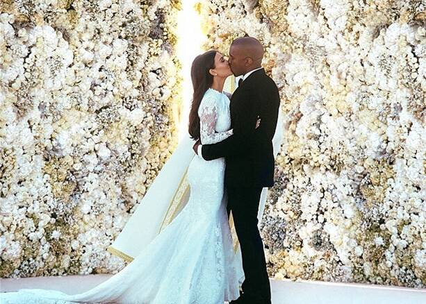 "TV reality star Kim Kardashian shared images of her wedding to rapper Kanye West on Instagram. She posted the images of their first kiss as 'man and wife', captioning it, ""Mr. & Mrs. Kanye West"". Kim and Kanye tied the knot on May 24 in Italy. (Source: Instagram)"