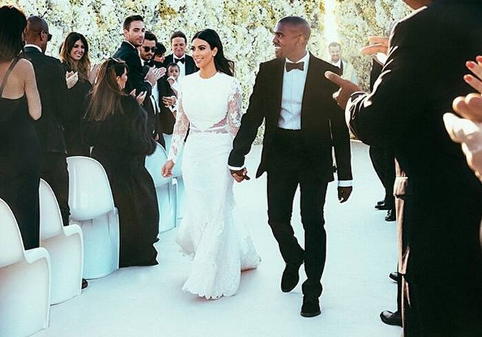 "Kim Kardashian wore a Givenchy haute couture gown for her walk down the aisle at the scenic Forte di Belvedere in Florence, Italy. (Source: Instagram)<br /><a href=""http://indianexpress.com/article/entertainment/television/kim-kardashian-wears-givenchys-riccardo-tisci-wedding-gown/"">Click on link to read more.</a><br /><br />Ahead: Kim Kardashian, Kanye West wed in Florence fortress"