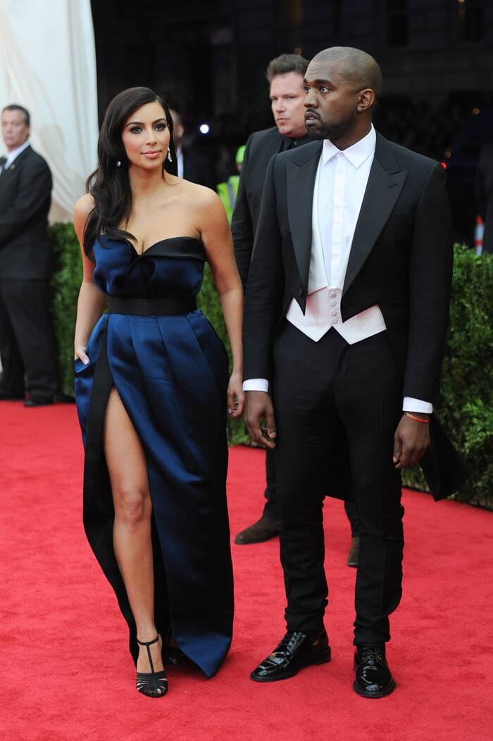 Kim Kardashian went for a thigh-high slit dress by Lanvin while fiancé Kanye West was suave in a tuxedo. (AP)