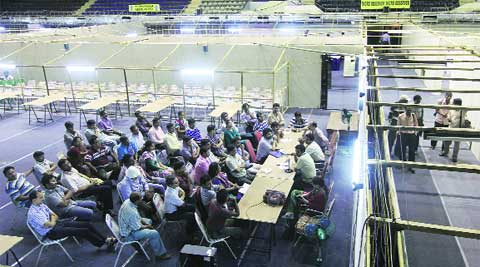 Polling personnel, during a training session at Netaji Indoor Stadium, Kolkata, one of the venues for counting of votes on Thursday.  ( Source : Express photo by Partha Paul )