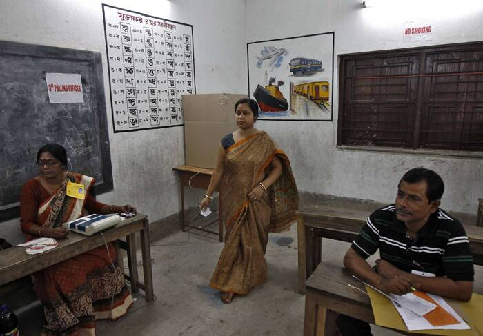A voter leaves after casting her vote inside a polling station in the final phase of the general election in Kolkata. ( Source: Reuters )