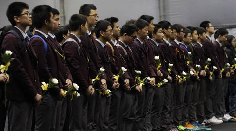 High school students pay tribute to the victims of the sunken ferry Sewol at a group memorial altar in Ansan, south of Seoul. (AP)