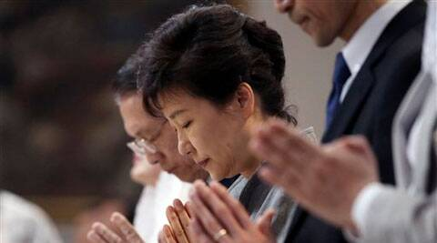 South Korean President Park Geun-hye prays during a serves to pay tribute to victims of the sunken ferry Sewol at a Catholic church in Seoul, South Korea on Sunday.