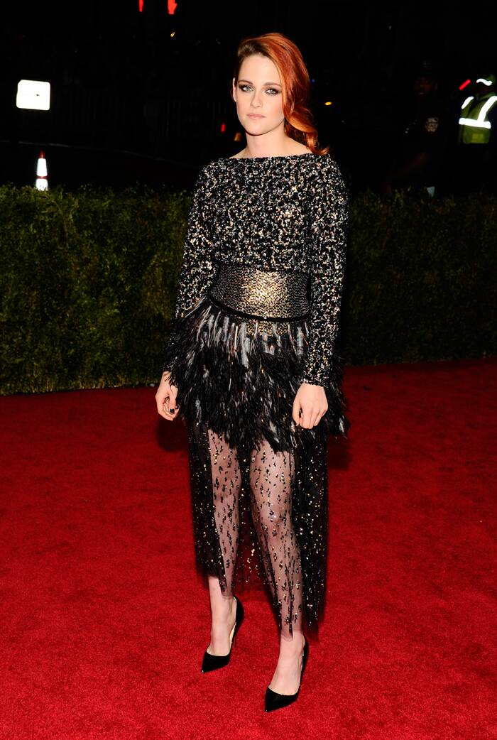 'Twilight' beauty Kristen Stewart, who is the face of Chanel, represteneded the brand on the red carpet in a gold sequin, tulle and feather embroidered dress with Christian Louboutin stilettos. (AP)