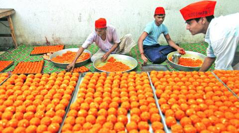Over 2,500 kg of motichoor laddoos are ready and waiting at the BJP headquarters. (Source: Express photo by Oinam Anand)