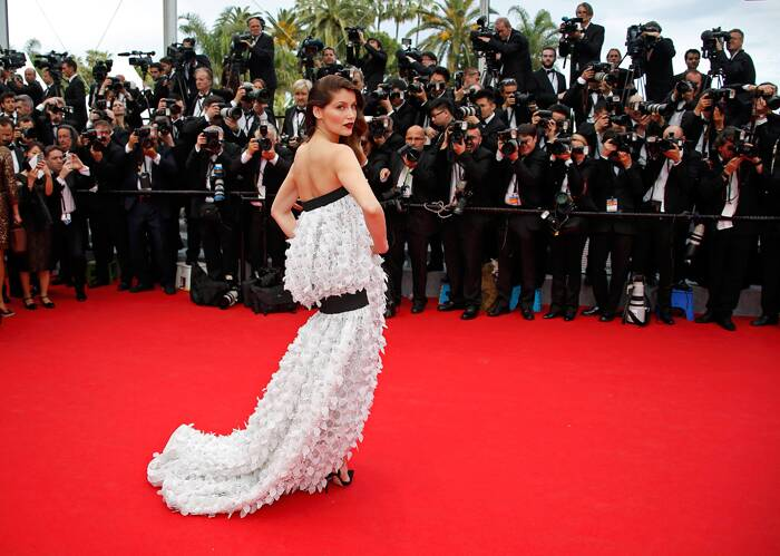 Model and actress Laetitia Casta had an interesting pick for the glamorous night. <br /><br /> Seen here, Laetitia shows off her slender frame as she poses on the red carpet as she arrived for the opening ceremony of the 67th Cannes Film Festival and the screening of the 'Grace of Monaco'. (Source: Reuters)