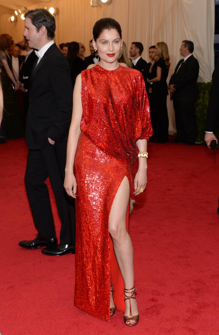 French actress and model Laetitia Casta matched the carpet in a shimmey red number. (AP)