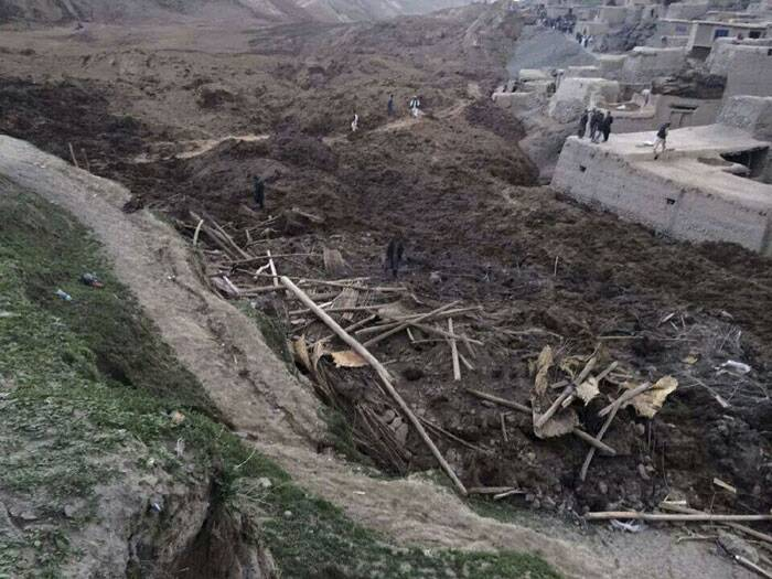 Rescuers searched for survivors after a landslide buried an Afghan village, killing 350 people and leaving thousands of others feared dead amid warnings that more earth could sweep down the hillside. (AP)