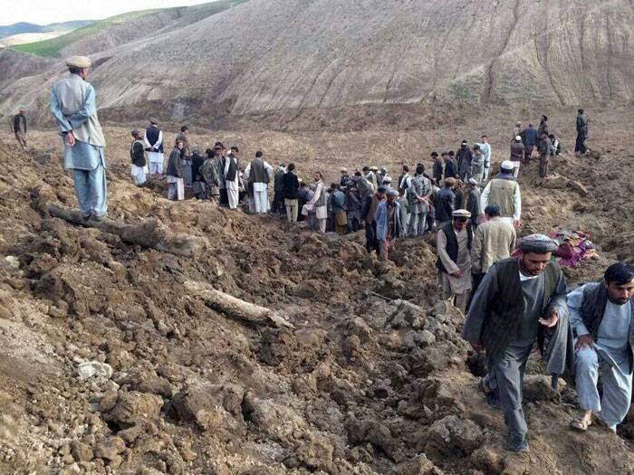 Local people tried to dig out victims trapped under a massive river of mud that engulfed Aab Bareek village in Badakhshan province where little sign remained of hundreds of destroyed homes. (AP)
