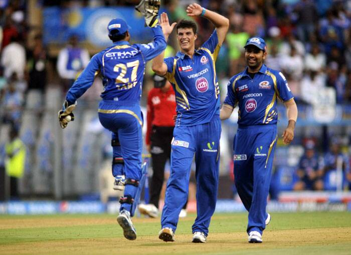 Playing his first match for Mumbai Indians in IPL 7, South African fast bowler  Marchant de Lange took the crucial wickets of Dinesh Karthik and Manoj Tiwary.  (Source: Express Photo by Kevin D'Souza)