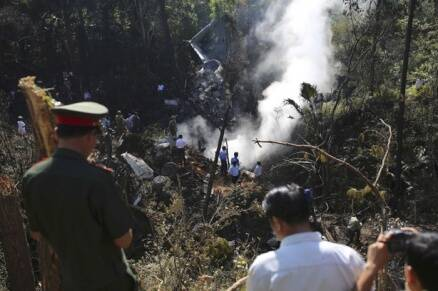Laos air force plane crashes, defence minister reported dead