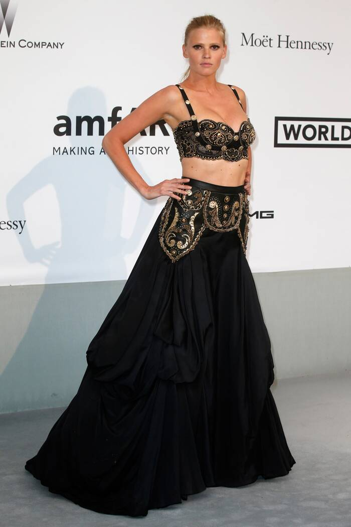 Dutch beauty Lara Stone wore a vintage Gianni Versace stunning gold and black bra bodice and a full skirt. (Source: Reuters)