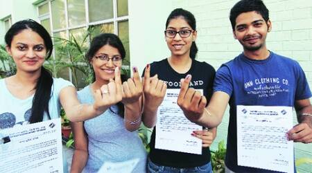 First-time voters with their appreciation letters, at polling booths in Mohali Wednesday.