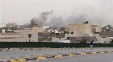 In this image made from video provided by the Libyan national army via AP Television, smoke rises over the parliament area after troops of Gen. Khalifa Hifter targeted Islamist lawmakers and officials at the parliament in Tripoli, Libya on Sunday. (AP)