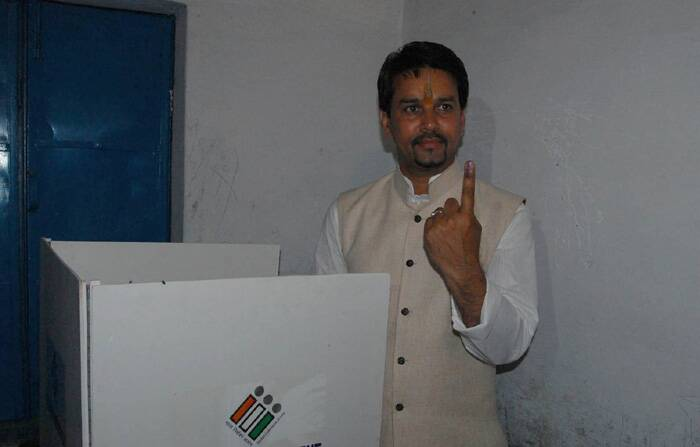 BJP candidate for Hamirpur Lok Sabha candidate Anurag Thakur shows the ink mark on his finger after casting vote for Lok Sabha election at a polling booth on Wednesday. (Express photo)