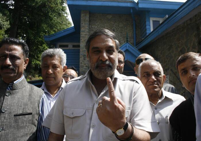 Union Minister Anand Sharma shows the ink mark on his finger after casting vote for Lok Sabha election at a polling booth in Shimla on Wednesday. (Express photo by Lalit Kumar)