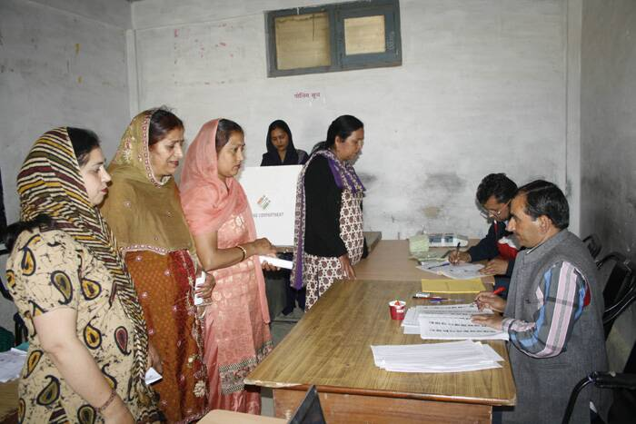 Voters cast her vote for Lok Sabha election at a polling booth in Shimla on Wednesday. (Express photo by Lalit Kumar)