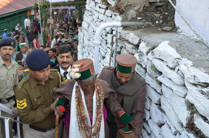 First voter of Independent India Shyam Saran going for casts his votes for the Lok Sabha eleltion at Kalpa, in Kinnaur district on Wednesday. (Express photo by Lalit Kumar)