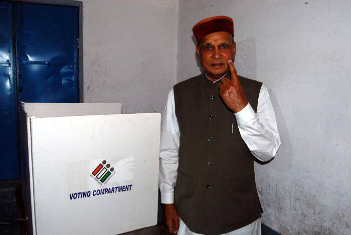 Former Chief Minister Prem Kumar Dhumal shows the ink mark on his finger after casting vote for Lok Sabha election at a polling booth on Wednesday. (Express photo by Lalit Kumar)