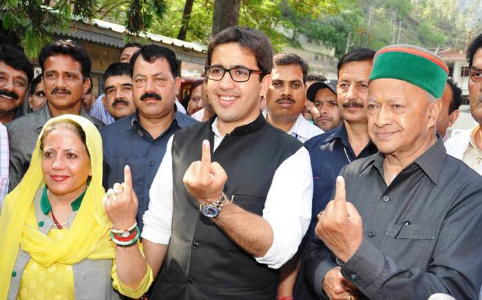 Chief Minister Virbhadra Singh, with his family, shows the ink mark on his finger after casting vote for Lok Sabha election at a polling booth at Rampur in Shimla on Wednesday. Express photo by (Lalit Kumar)