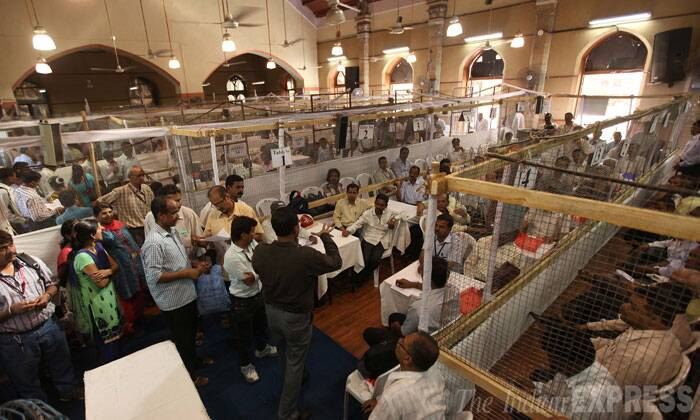 People rehearse  for the counting of votes a day ahead of the actual day at Elphinstone College where vote counting will take place for couple of constituencies in Mumbai on Thursday. (Source: Express Photo by Pradeep Kochrekar)