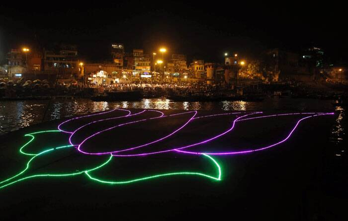Illuminated lotus by river Ganges in Varanasi. (AP)