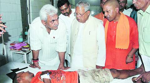 Union MSME minister Kalraj Mishra, MoS (Railways) Manoj Sinha and BJP MP Yogi Adityanath enquire about the well-being of a passenger injured in Gorakhdham train tragedy, at a hospital in Gorakhpur, Tuesday. (PTI)