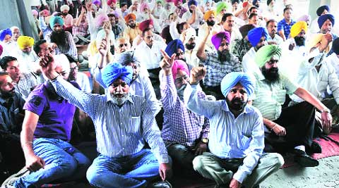 Employees protest outside the Thapar Hall  at PAU in Ludhiana on Wednesday. Gurmeet Singh