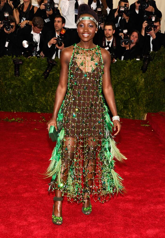 Academy Award winner Lupita Nyong'o displayed a somewhat bizarre choice of wardrobe when she walked the red carpet at the Met Gala this year in a green feathered Prada creation.