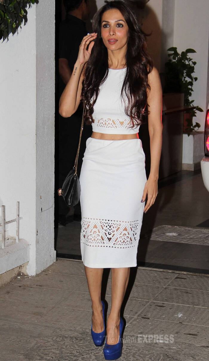 Actress-producer Malaika Arora Khan was oozing oomph in a white top and skirt with cut out detailing. She finished off her look with eletric blue pumps and side sling bag. (Source: Varinder Chawla)