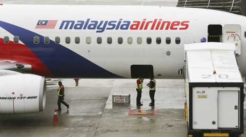 The Malaysian government on Tuesday released 45 pages of raw satellite data it used to determine the flight path of the missing jetliner. ( Source: AP )