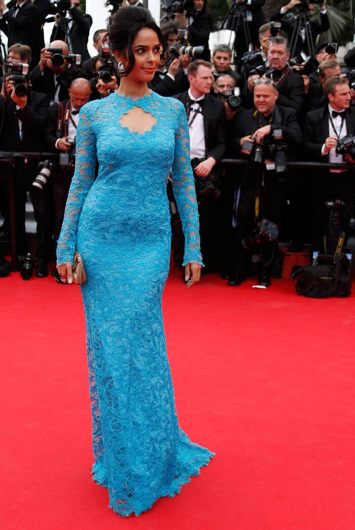 Mallika Sherwat was beautiful in a lovely blue lace Emilio Pucci gown. <br /><br /> Seen here, the actress poses for the photogs on the red carpet as she arrives for the opening ceremony of the 67th Cannes Film Festival and the screening of the 'Grace of Monaco'.  (Source: Reuters)