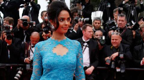 Mallika Sherawat looked demure and beautiful in a blue lace Emilio Pucci gown. ( Source: Reuters )