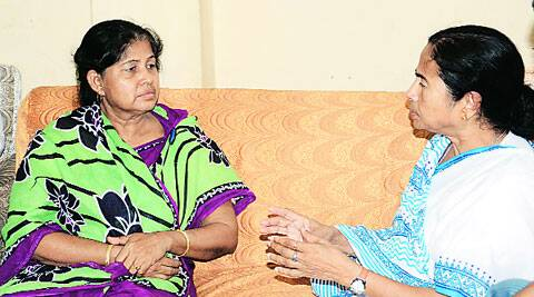 Mamata with Jaya Gayen, mother of Chhanda Gayen, at their residence, in Howrah on Friday. (Source: Express photo)