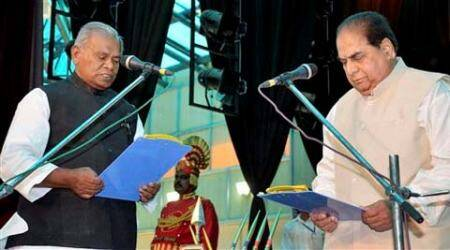 Bihar governor D Y Patil administering oath to new Chief Minister Jitan Ram Manjhi at Raj Bhawan in Patna on Tuesday. (Source: PTI)