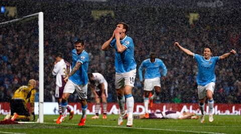 Edin Dzeko scored twice in City's 4-0 win over Aston Villa on Wednesday leaving City needing just a point from the final game of the season. (Reuters)