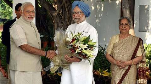 narendra modi, manmohan singh, modi manmohan meet, modi government, modi govt one year, congress, congress suit boot ki sarkar, BJPs multi crore campaign, IE column