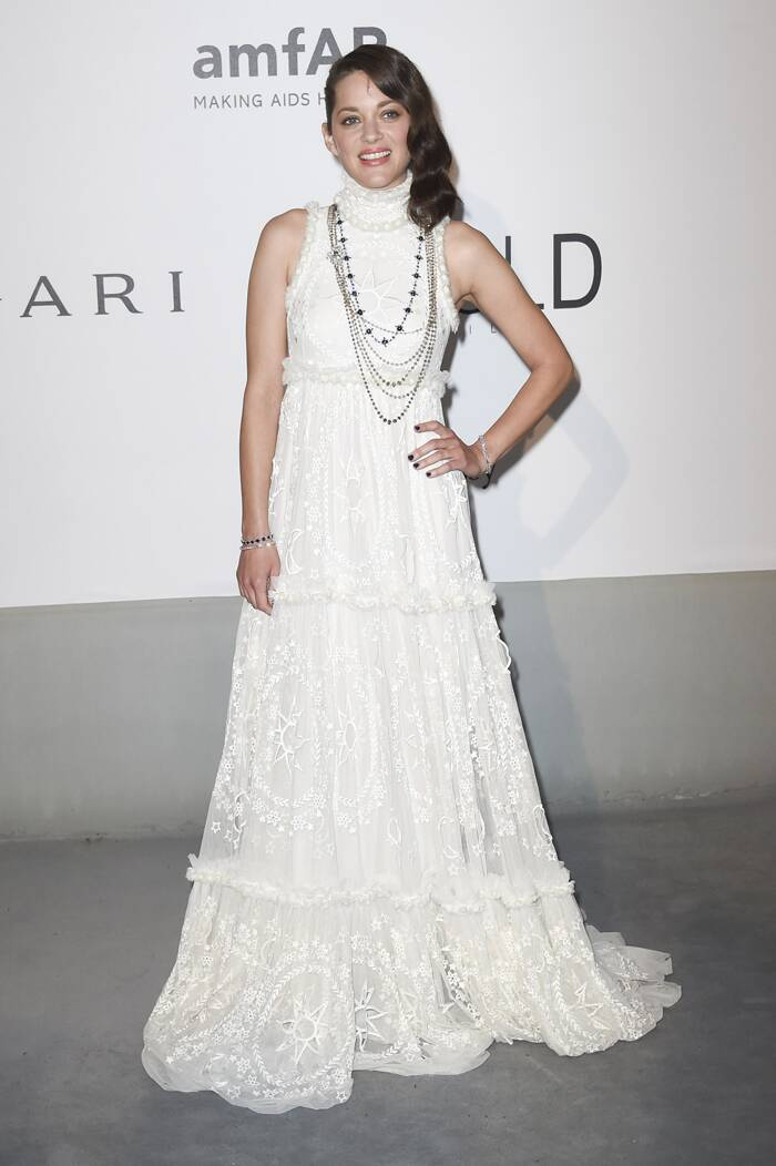 French actress Marion Cotillard was a vision in a beautiful lace Alexander McQueen gown paired with jewellery by Chopard.